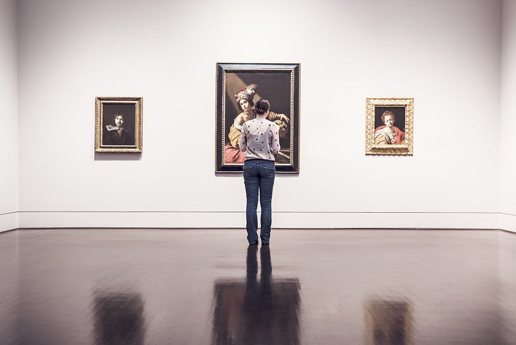Young Woman Alone in Gallery